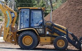 Milestone Landscaping backhoe